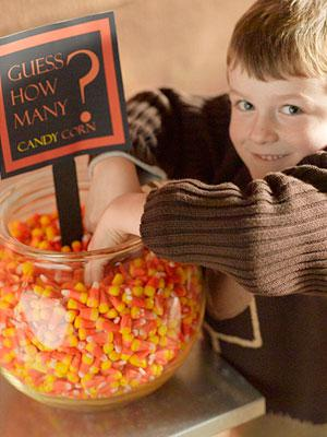 large glass container filled with candy corn for students to practice estimating