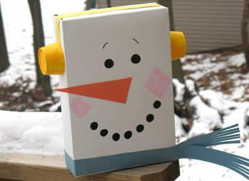 snowman craft made from a recycled cereal box