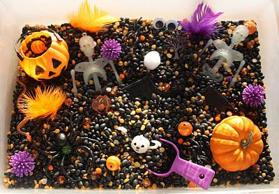 plastic bin filled with Halloween items