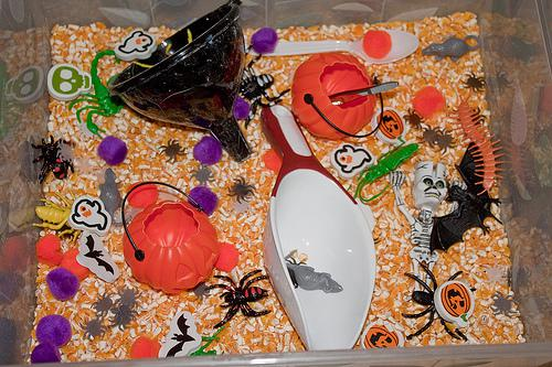 plastic bin filled with Halloween objects