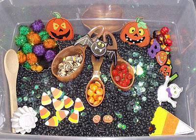 clear plastic bin filled with Halloween objects