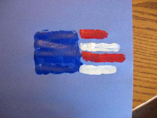 hand print flag on blue construction paper