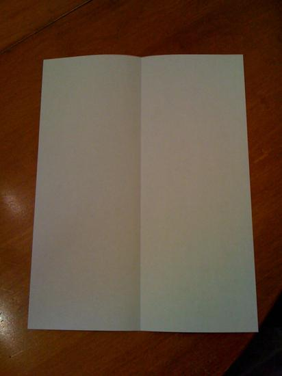 piece of white construction paper creased in half