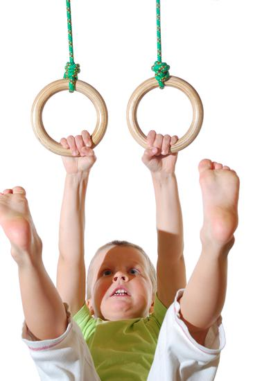 Young Boy Haning from Gymnastic Rings