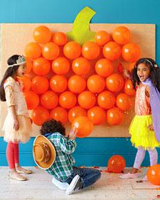 orange balloons displayed in the shape of a pumpkin