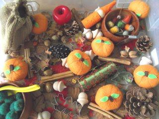 bin filled with fall themed objects