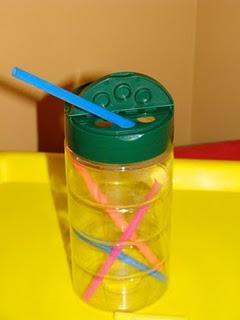 plastic Parmesan cheese and drinking straw preschool fine motor skill activity